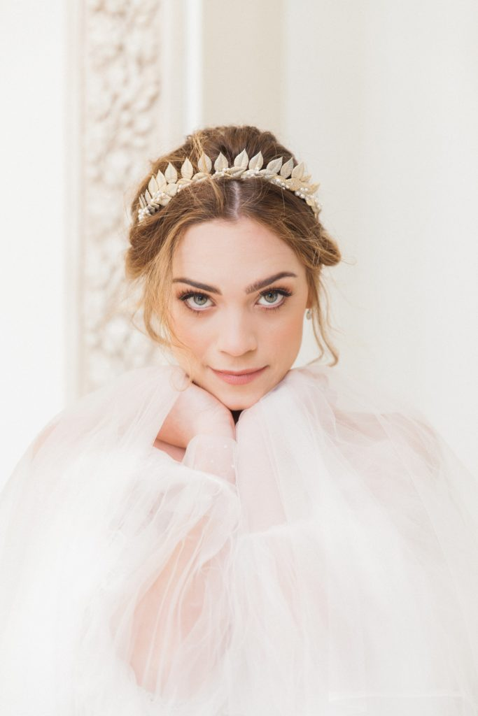 Portrait of a bride in a gold crown and a floaty, ethereal wedding dress by Chic Nostalgia