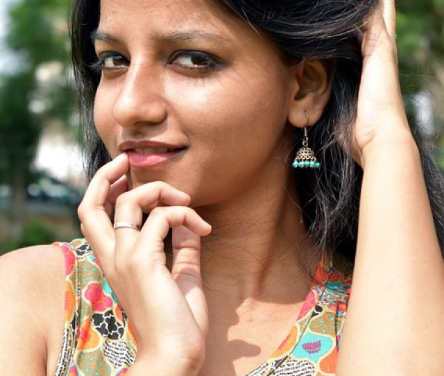 Young Slim Pretty Indian Girl Earrings