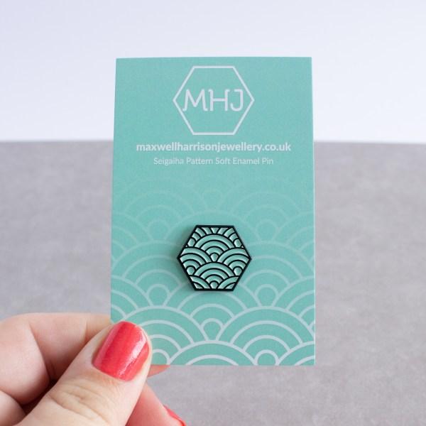 Seigaiha pattern hexagonal soft enamel pin - black and mint on backing card