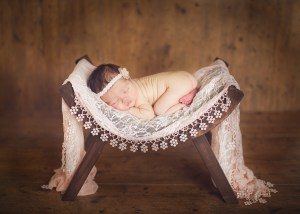 infant on a bench