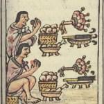 Deux hommes aztèques en train de manger