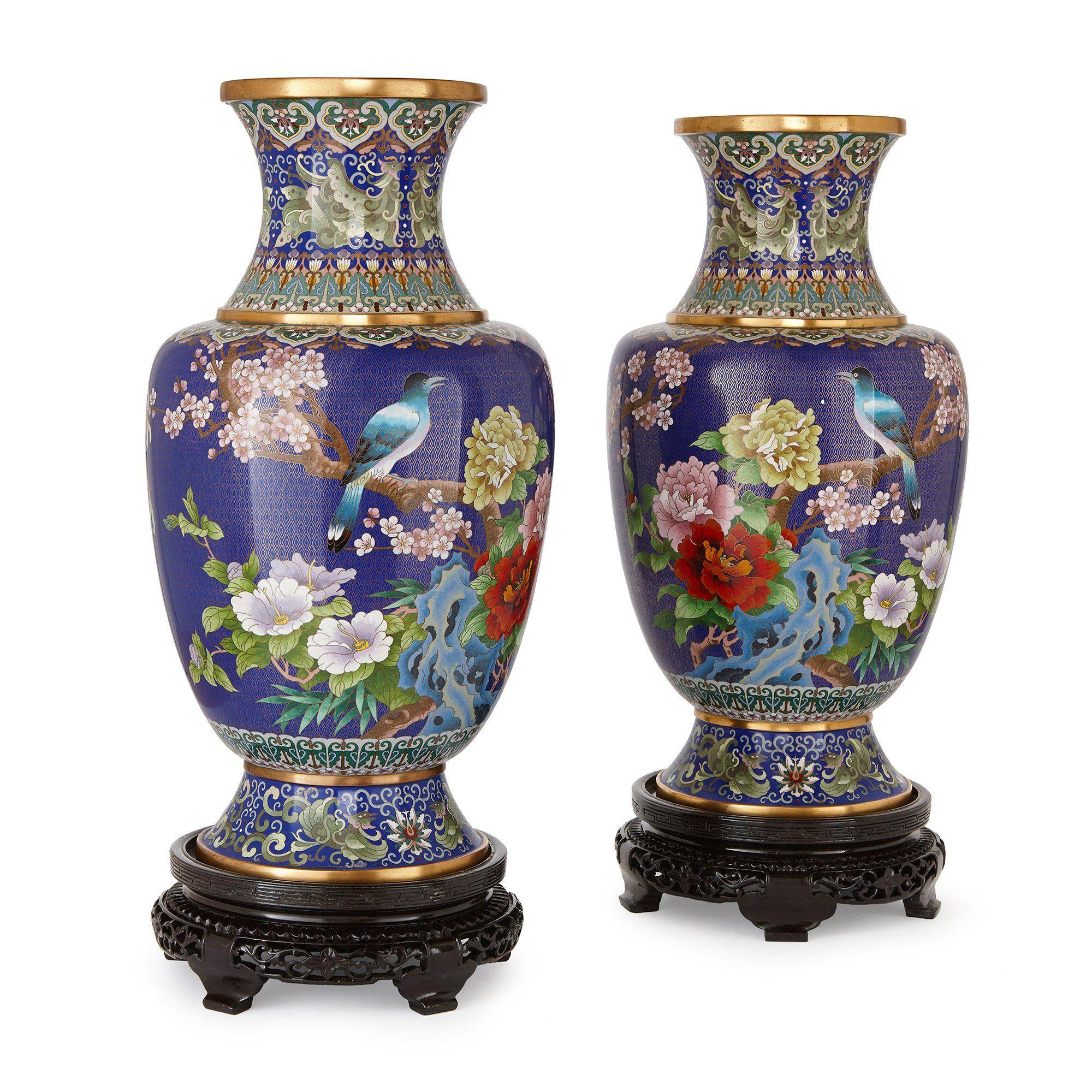 Pair of large Chinese cloisonn enamel vases on wooden