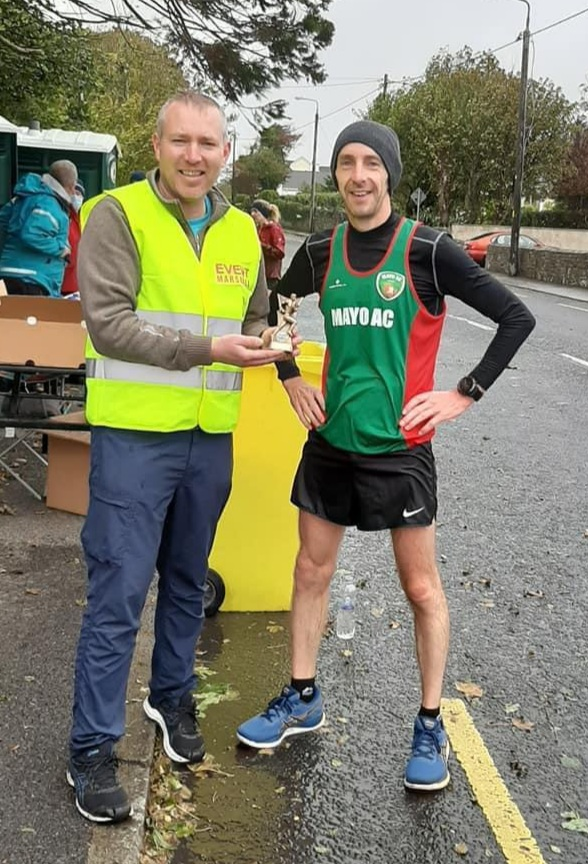 Event organiser Martin McHale presents John Gordon with marathon winner's prize