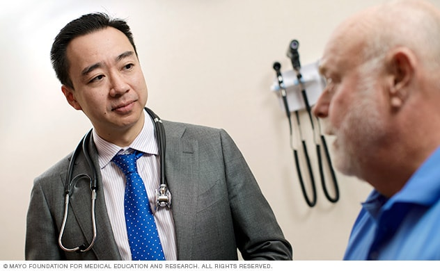 Doctor talks with a mature male patient