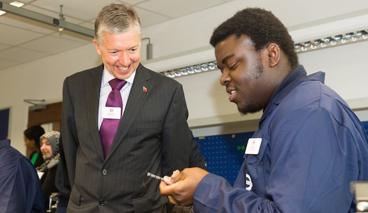 Tube boss Mike Brown with TfL apprentices. Image: TfL