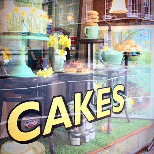 Cakes signage on a tearoom in Cambridge, England, dainty teacakes and teapots
