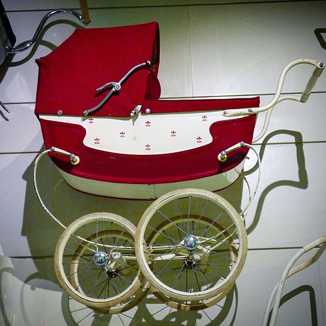 Red baby carriage on display at Glasgow Riverside Museum, Transport museum red pram