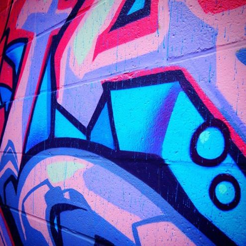 Pink and blue spray art graffiti in Toronto's Graffiti Alley