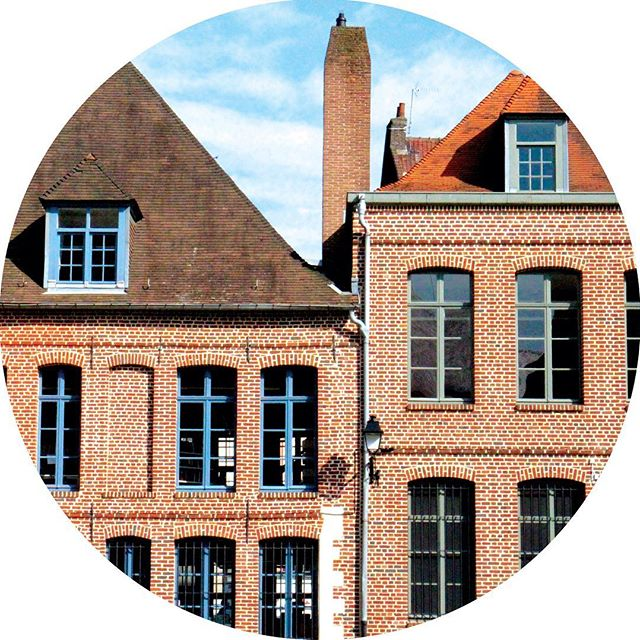Brick houses with colourful window frames in Lille France