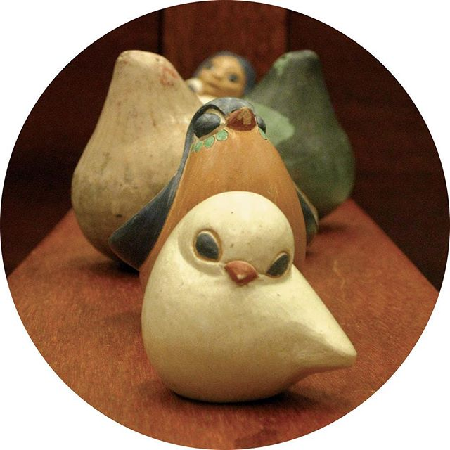 Cute ceramic birds arranged in a line