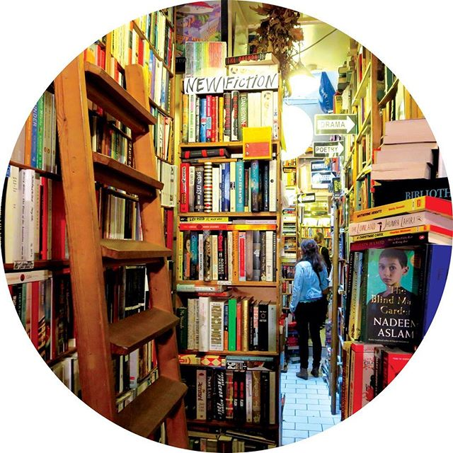 Abbey Books Paris bookstore with books stacked from floor to ceiling
