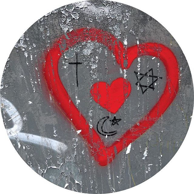 Coexist graffiti in Lille with all religious symbols encased in a heart