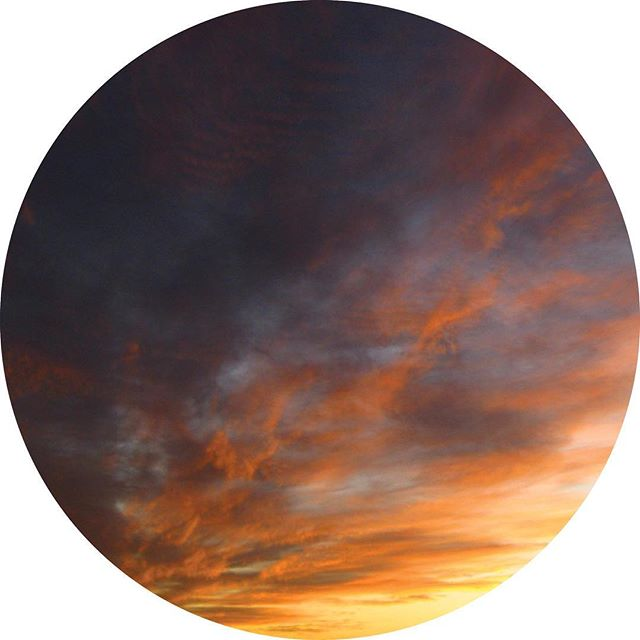 Sunset cloudscape abstract art that looks like a planet