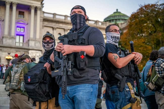 Armed men are becoming a common sight at Trump rallies. Credit - Associated Press