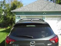 Do factory roof rack cross bars provide clearance above