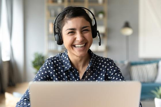 Woman with headset on laptop video