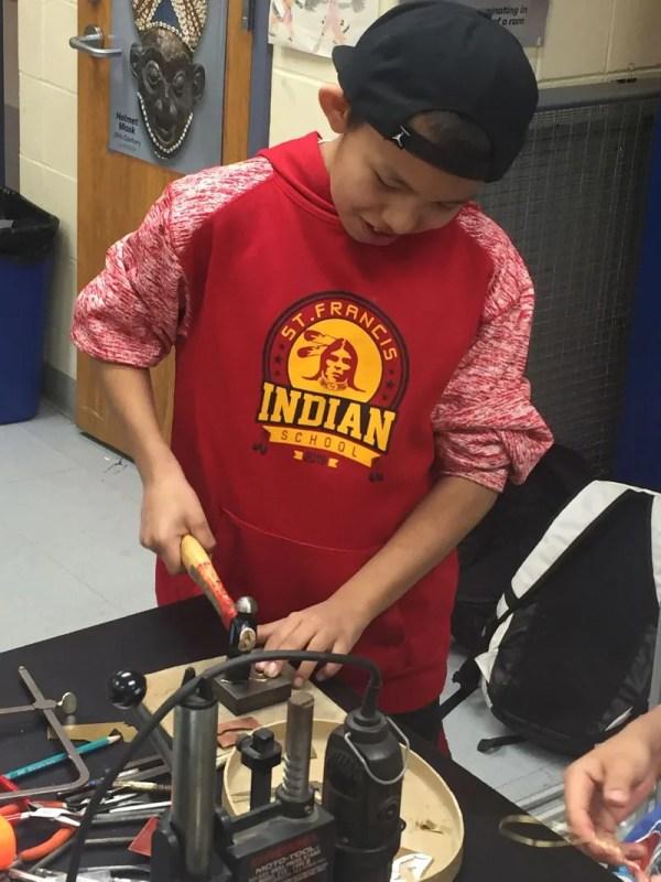 Rosebud Reservation student hammering