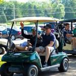 Golfers in golf carts