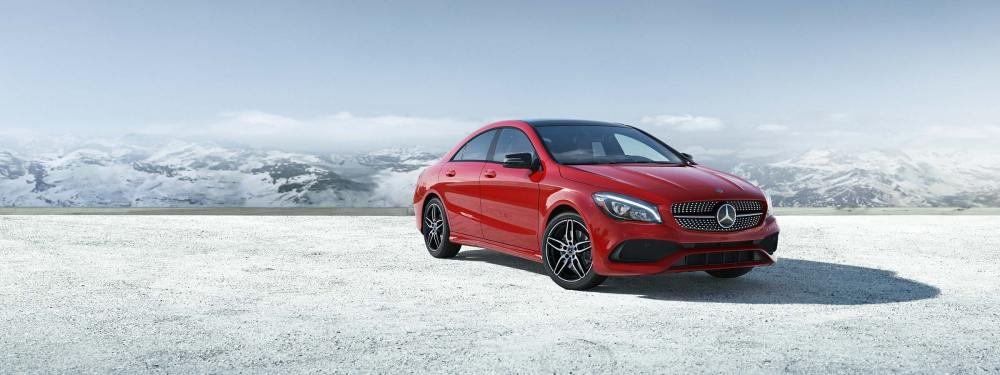 medium resolution of a red 2019 cla 250 coupe parked in front of snow covered mountains