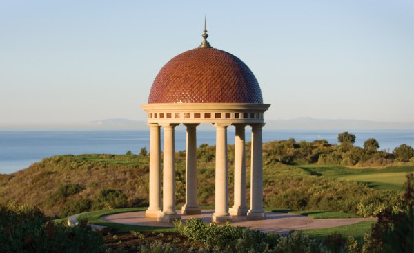 Pelican Hill Wedding Rotunda dome with specialty fish scale clay roof tile, on grassy hill, ocean horizon in the background