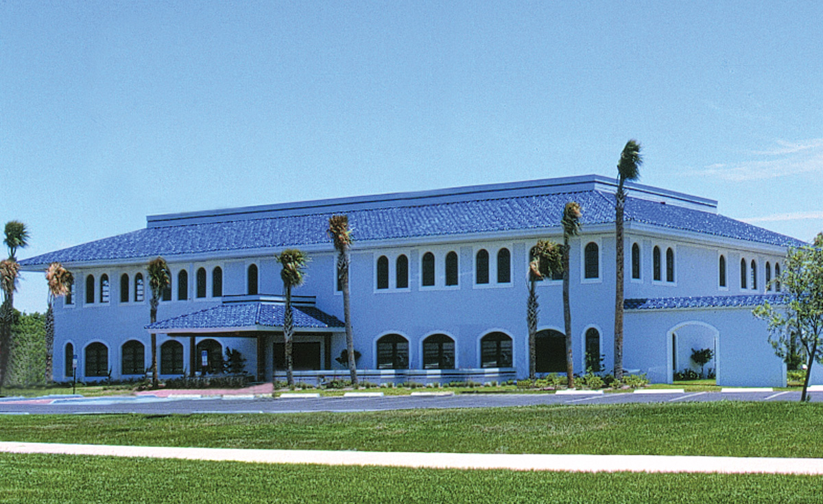 Improved S tile in blue on office building in Florida