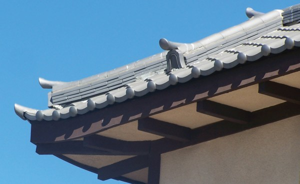 detail of oriental Japanese clay roof tile in C09 Japanese black ibushi on restaurant in Long Beach california