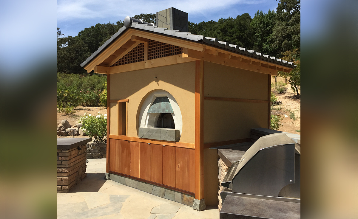 Oriental-Japanese clay roof tile in C09 Japanese Black on a backyard pizza oven in Northern California