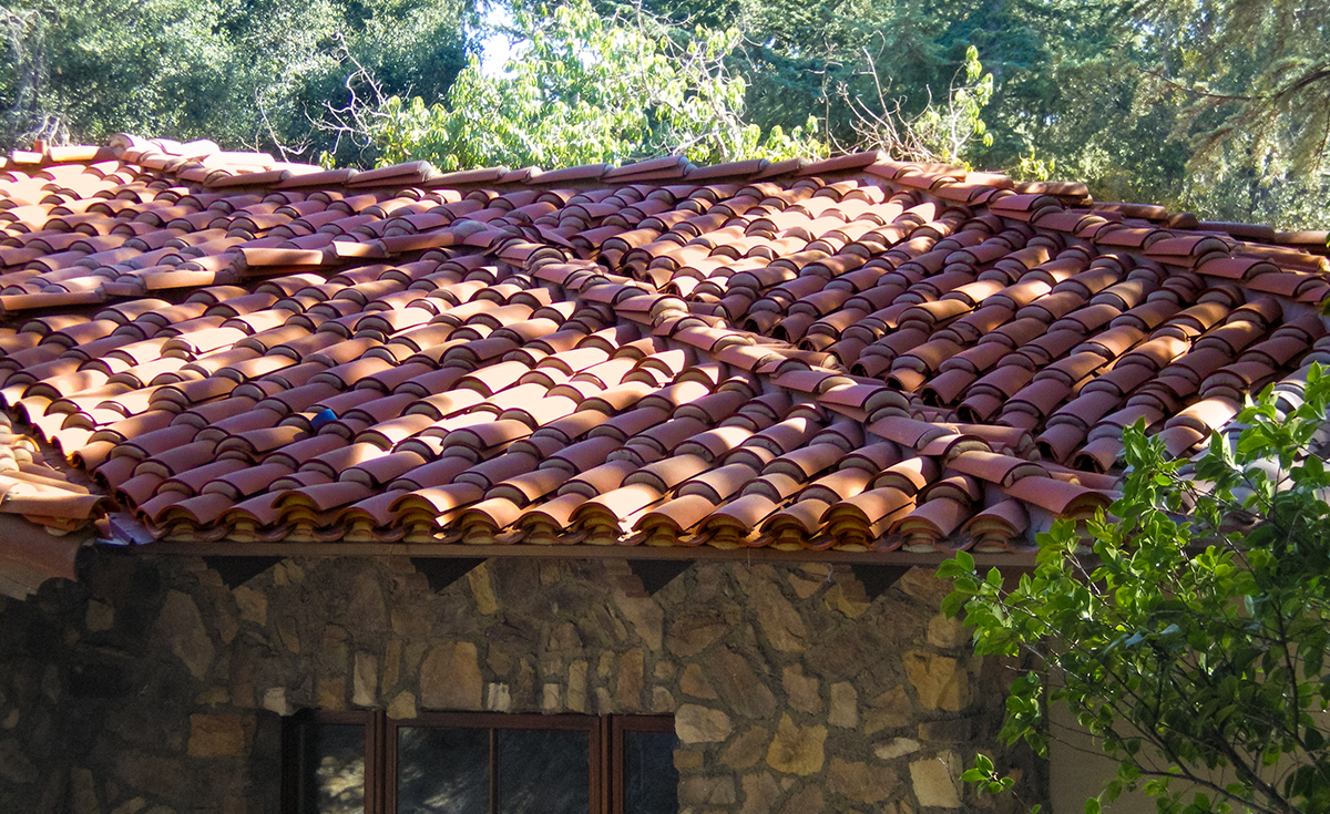 detail of classic tapered mission clay roof two piece tile in 67% F72 Mahogany and 33% F45 tobacco with weepy mortar and field boosting on custom home in La Cañada Flintridge California