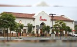 Chick Fil A at Outlets San Clemente, California featuring Corona Tapered Mission Spanish style two piece clay roof tile in 50% CC16L-R Old Santa Barbara Light, 50% CC16M-R Old Santa Barbara Medium with 100% CC16L Old Santa Barbara Light Pans and Birdstop.