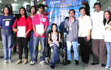 Aldrin D. Gabriel wearing Fuschia received the Gold Medal and Certificates in English Desktop Processing trade together with other participants. With him are (from left) Dir. Cecille Gutierrez of TESDA Women's Center, Dir. Catalina Fermin of NCWDP and TESDA Director Washington Agustin.