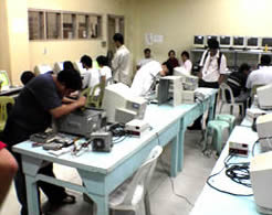 Sir Ervin R. Reyes (1st from left) and Ronald Josef C. Santiago (next) assembles a Pentium I computer of University of Makati. Sir Ervin and Ronald both received silver medals.