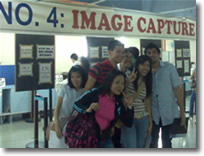 Students pose behind the NBI Clearance Photo Lane