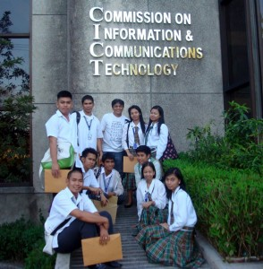 MCCID participants pose in front of CICT facade.