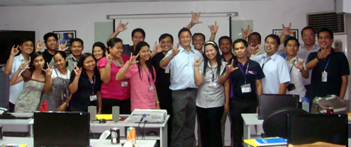 Air21 sign language trainees wave their i-love-you signs.