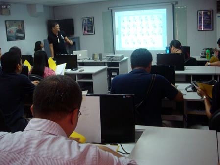 Sir Jojo teaches sign language to Air21 employees.