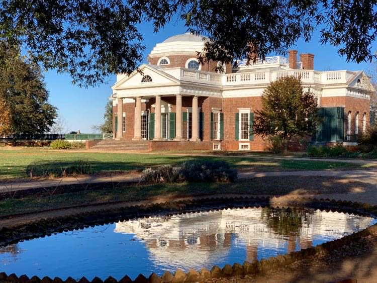 Thomas Jefferson's Monticello home reflected in pond water