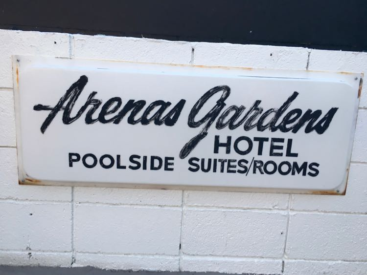 retro Arena Gardens Hotel sign at Amin Casa