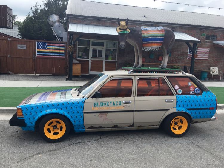 funky Block Taco delivery car with donkey statue on top