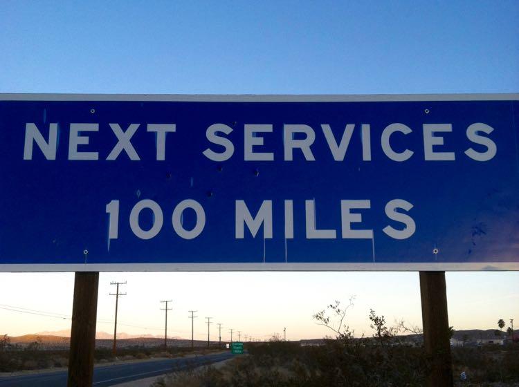 Next Service 100 Miles road sign in California desert