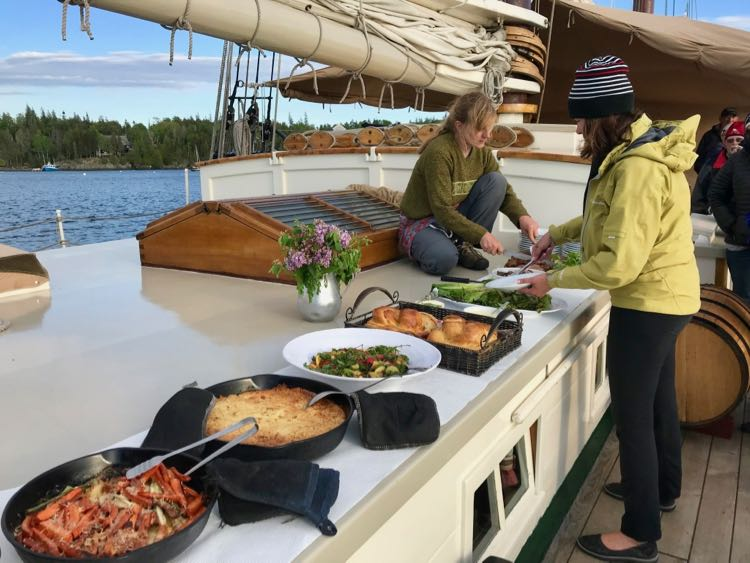 Dinner served on deck on a J&E Riggin Maine Windjammer cruise