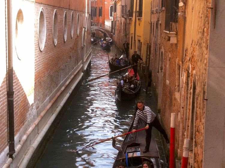 gondolas in a canal in Venice Italy