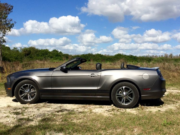 Ford Mustang convertible on dirt road in Everglades