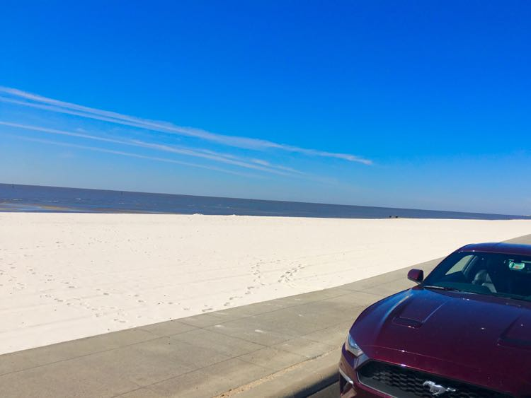 parking spot next to beach sand of Mississippi Gulf Coast