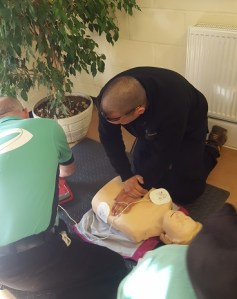 CPR practice with defibrillator