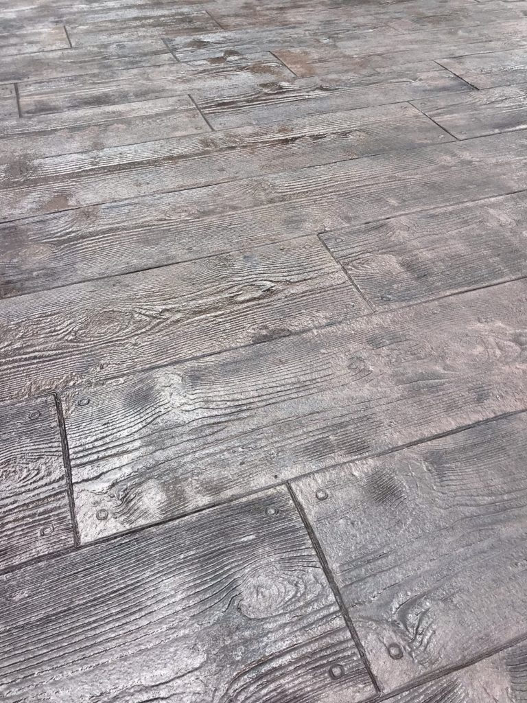stamped concrete patio pool house