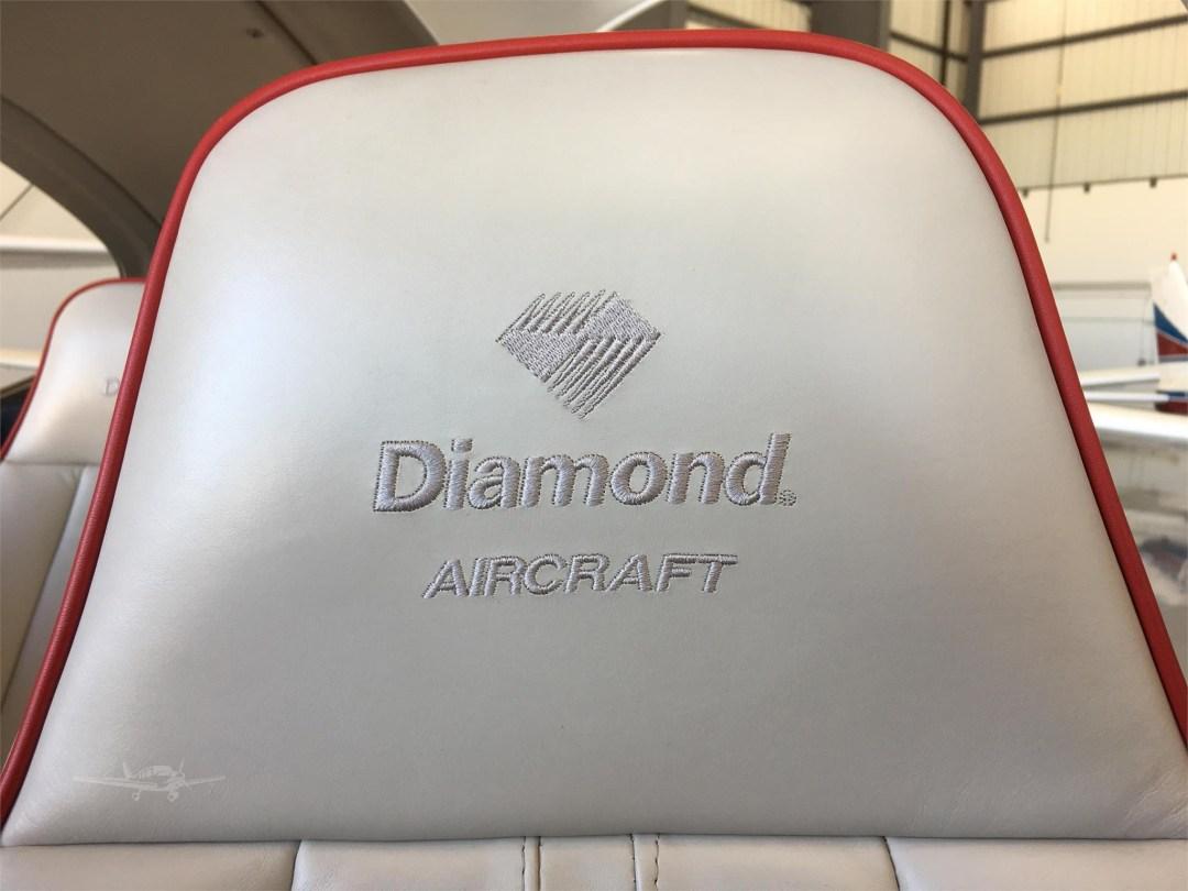 2010 DIAMOND DA40 XLS N355DS diamond aircraft logo on seat