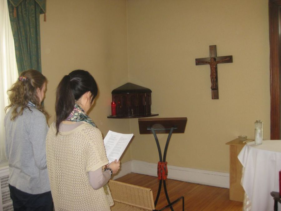 Members of the Newman community pray the Liturgy of the Hours in the Centre's chapel (photo credit unknown)