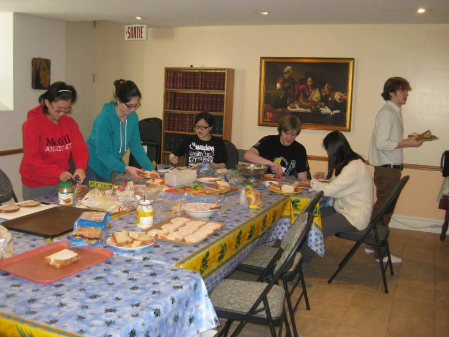 Newmanites help prepare sandwiches for the homeless of Montreal (photo courtesy of Holly Garnett)