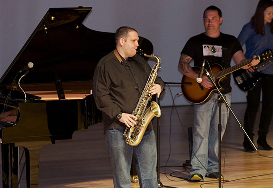 Online saxophone learner Will performing with his band,