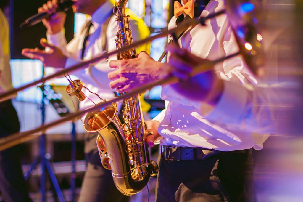 saxophone playing in a band